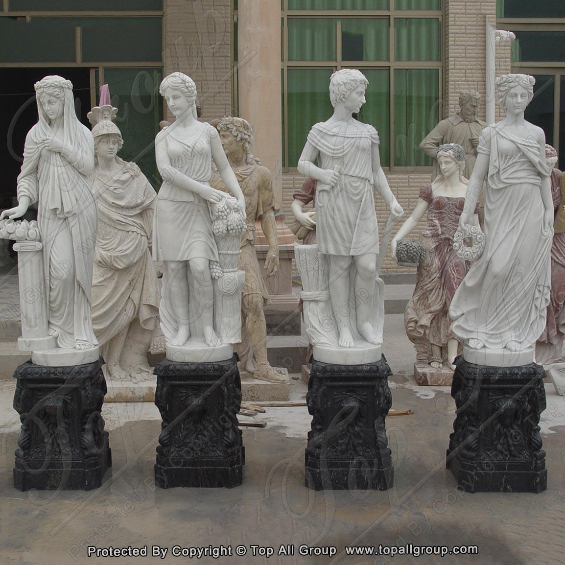 White marble four season statue with black base